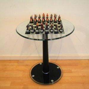Glass Table And Fantasy Chess Pieces